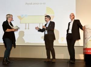 Minister Hägglund och SKLs förste vice ordförande Lennart Gabrielsson på scenen